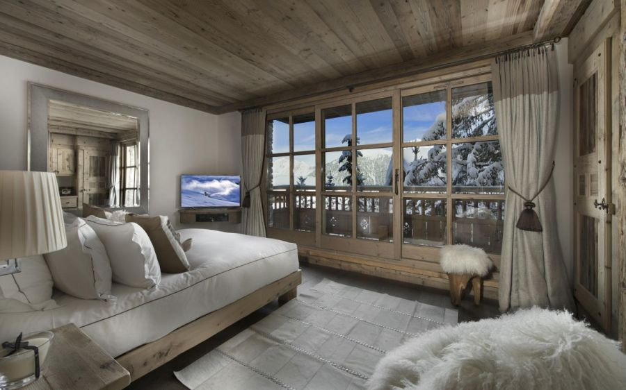 Large glass windows offer grand views of the Alps