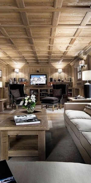 Large living room with fireplace in the French Alps Retreat
