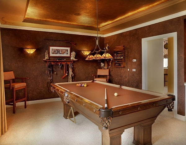 Lovely leather walls in game room create an opulent setting
