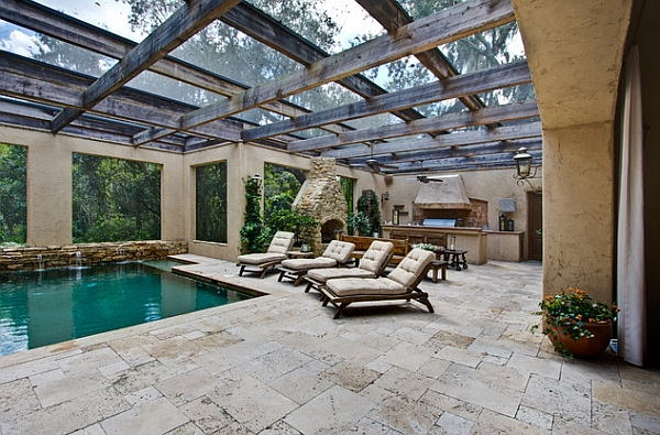 Lovely pool area combines Mediterranean style with a touch of rustic charm