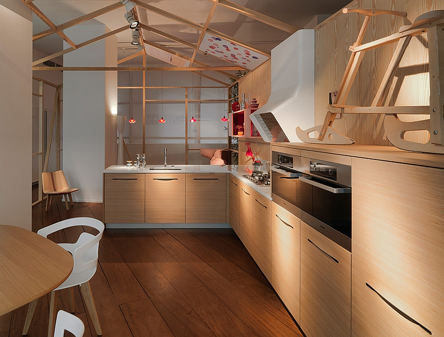 Lovely red accents add color to the kitchen