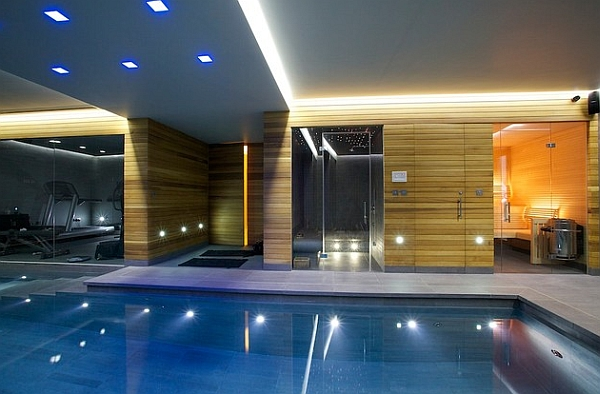 Luxurious indoor pool with an attached sauna and shower area