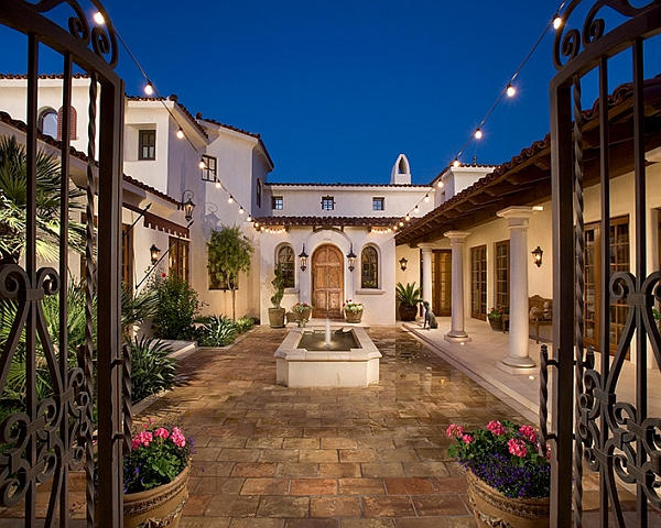 Mediterranean style patio uses the string lights in an understated fashion