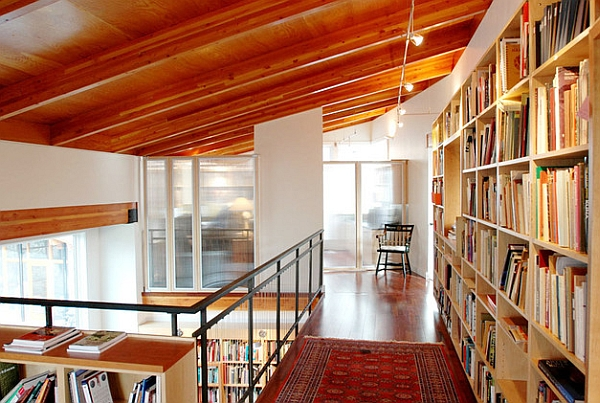 Mezzanines seem to be a popular choice to showcase the home library proudly!