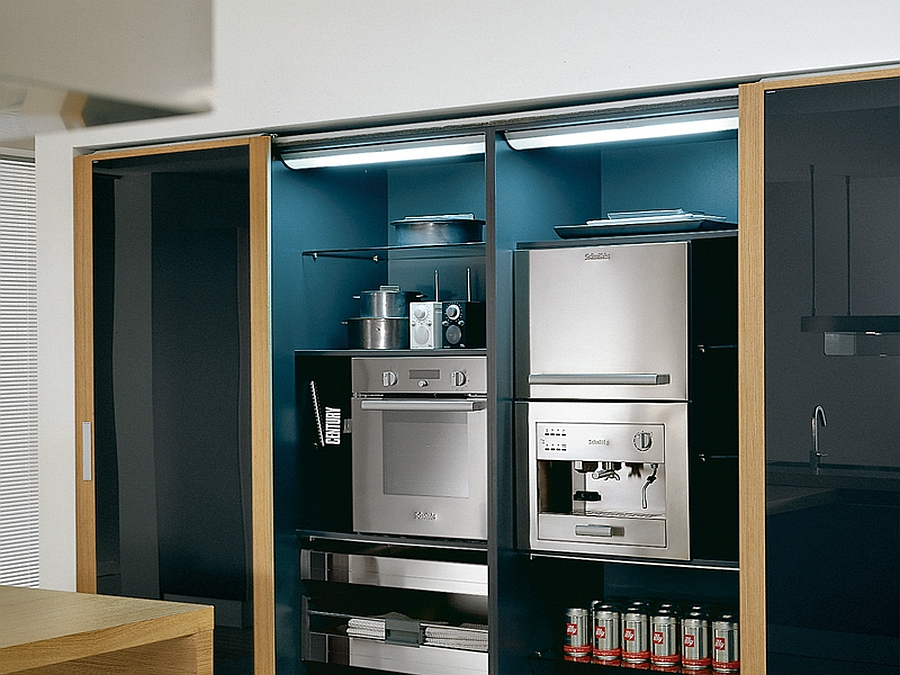 Modern kitchen appliances tucked inside cabinets