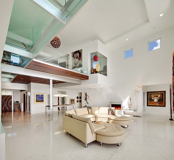 Modern living space with a mezzanine and a glass bridge