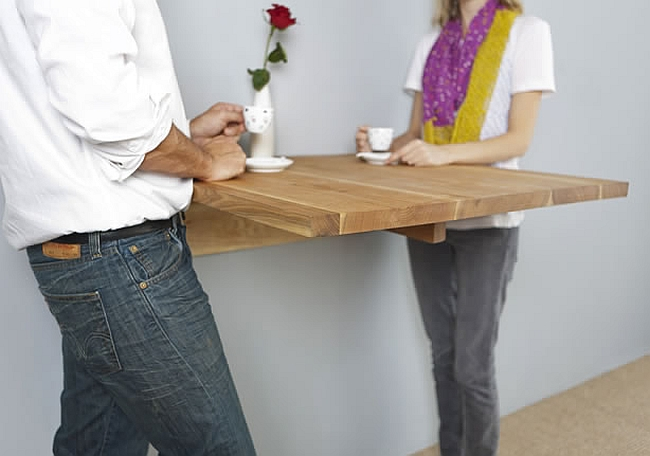 Modern wall mounted table at bar height