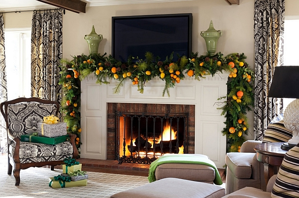 Natural orange and green Christmas decorations for the mantel