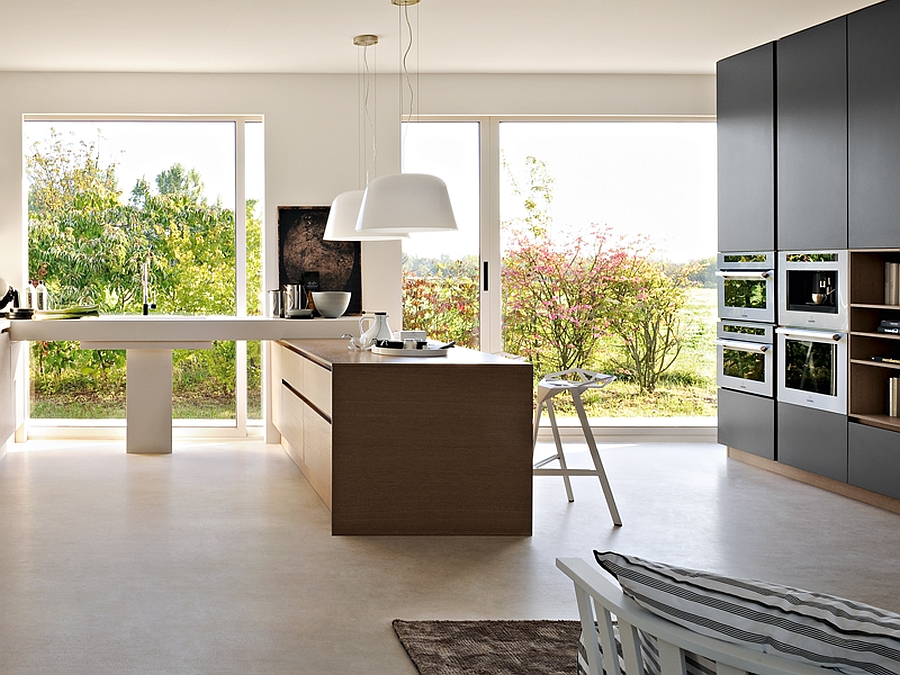 Open glass doors bring in the view outside the modern kitchen