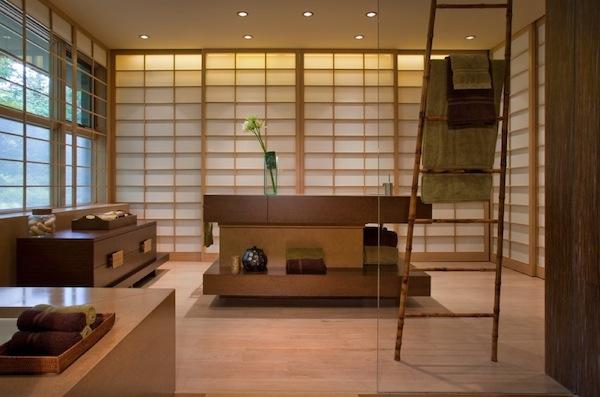 Oriental styled bathroom uses a ladder as towel rack