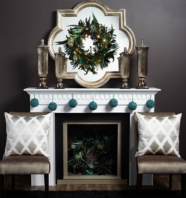 Pairing peacock wreaths and turquoise ornaments create a inimitable Christmas mantel!