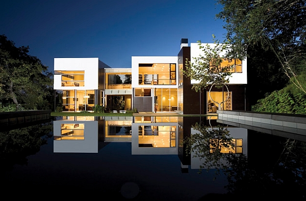 Picture-perfect reflection of the villa captured by the water feature