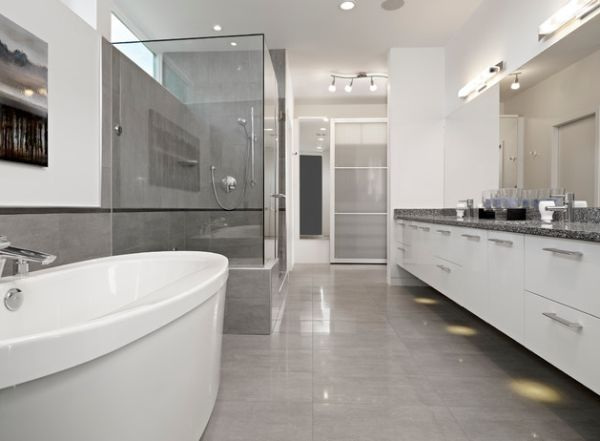 Polsihed modern bathroom in grey wiith elegant floor tiles