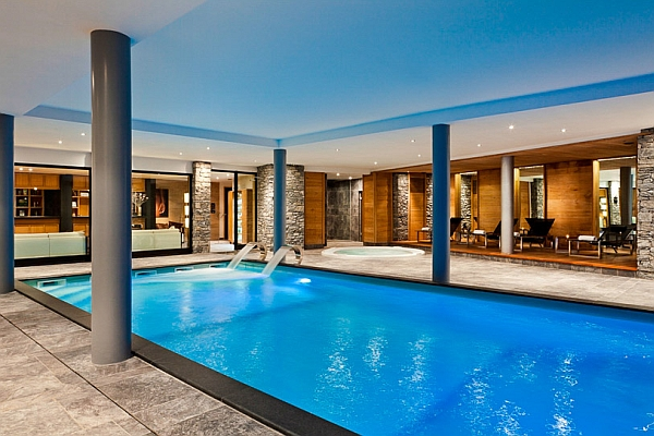 50 indoor swimming pool ideas taking a dip in style for Large swimming pool designs