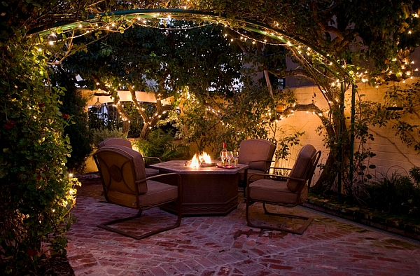 Romantic patio dining area illuminated beautifully