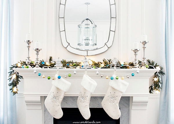 Sleek and stylish holiday mantel in white with hints of blue