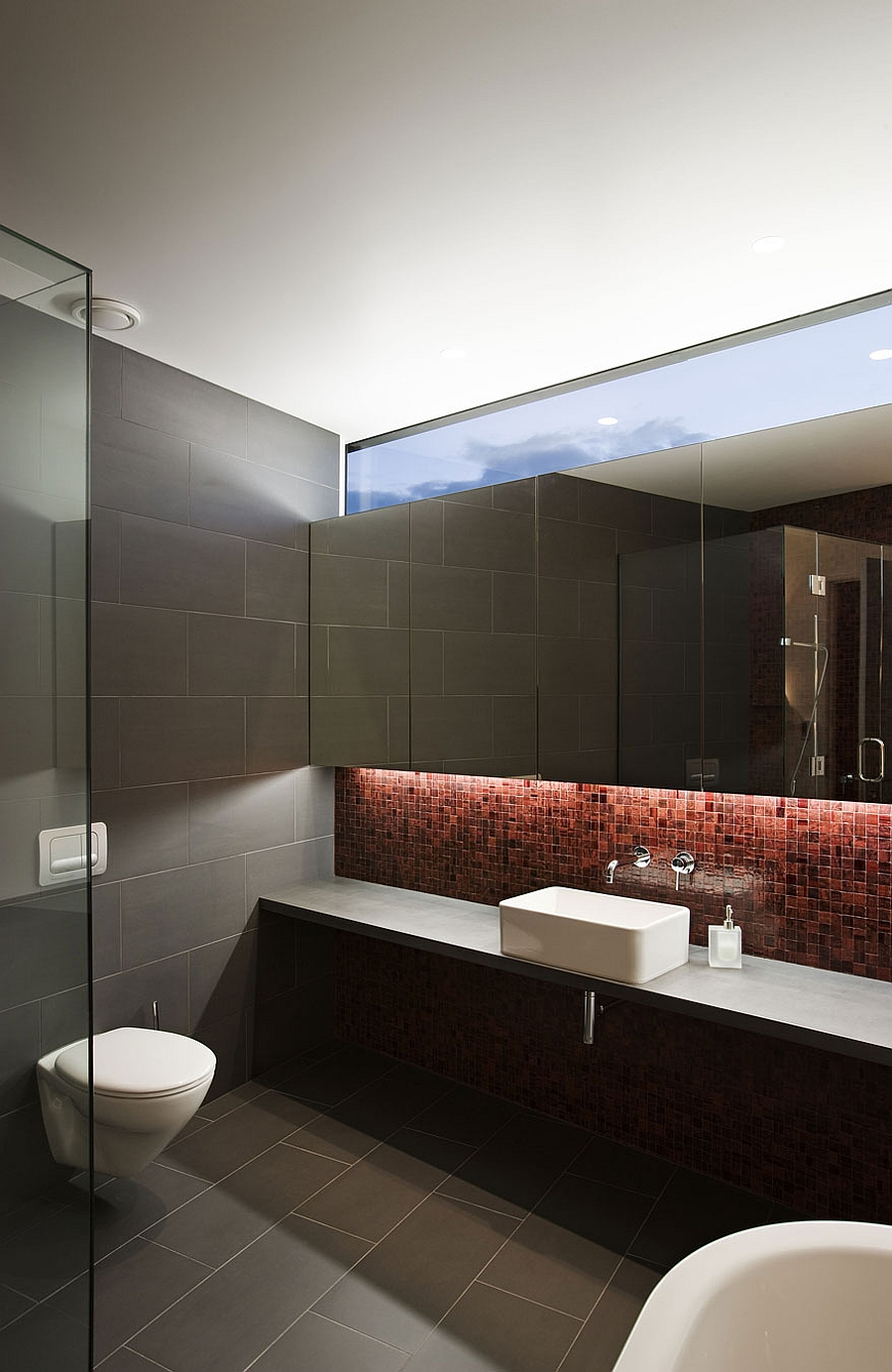 Sleek modern bathroom in grey and red