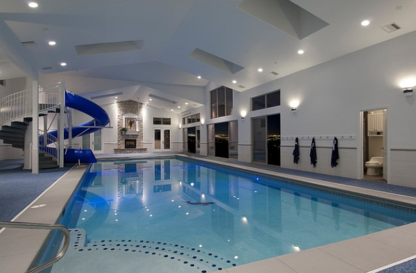 luxurious indoor pool with an attached sauna and shower area view in gallery slide your way to a refreshing dip