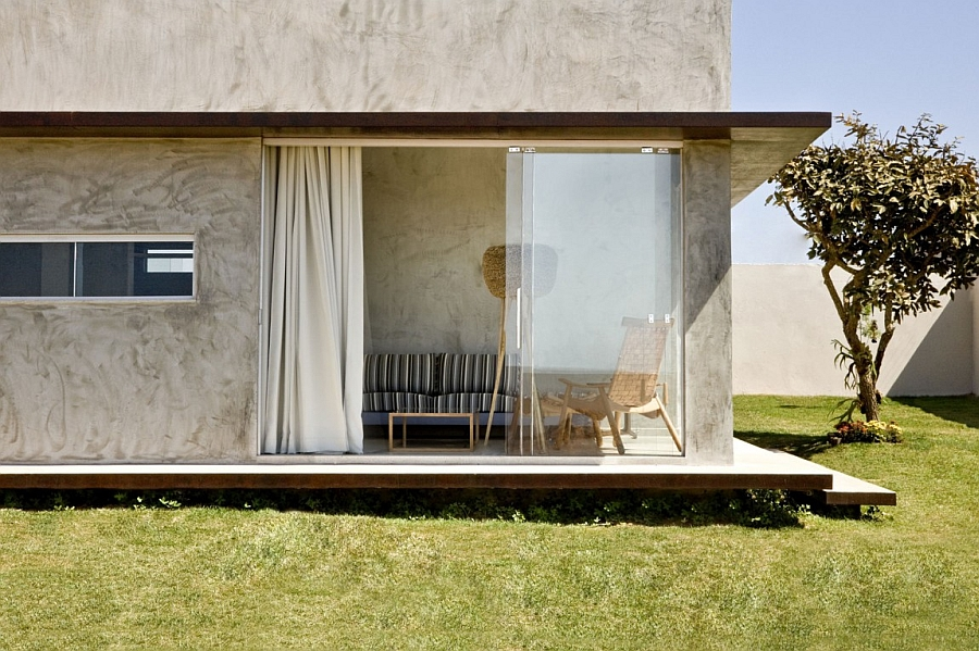 Sliding glass doors of the Box House Tiny Designs: Brilliant Box House With Bold Interiors