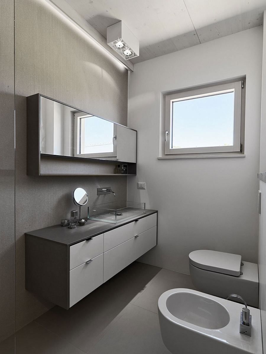 Small bathroom with floating vanity in grey