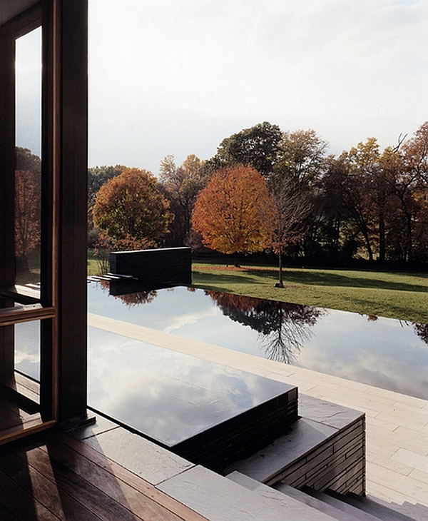 Small reflecting pool next to the window complements the larger infinity pool outside