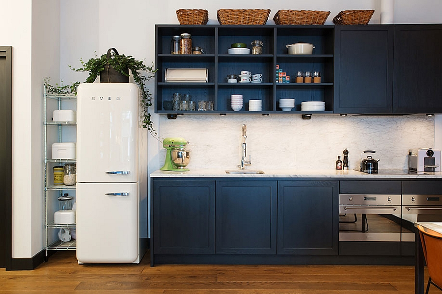 Small refrigerator and classic kitchen shelves in navy blue