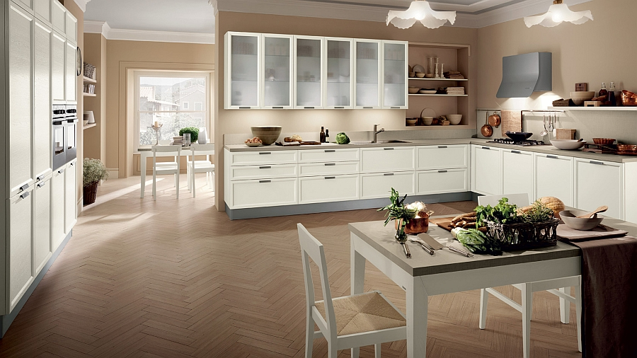 Smart white kitchen design with a dining table