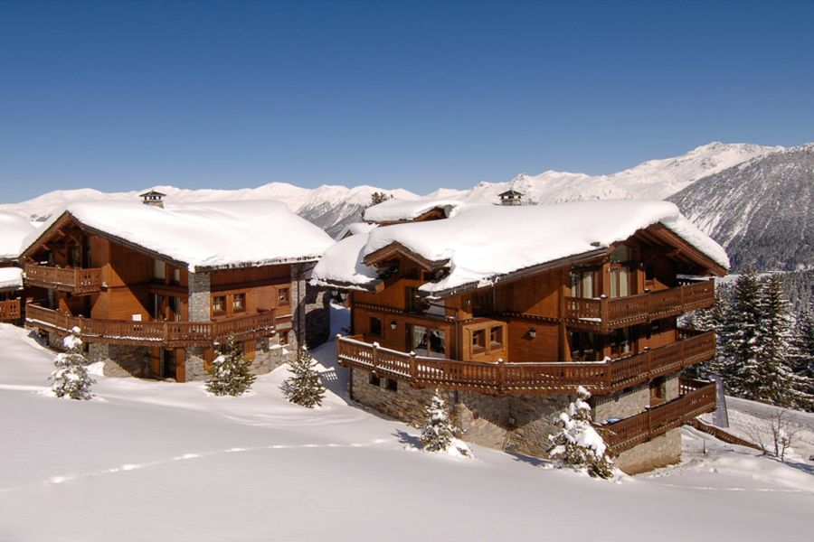 Snow covered roofs of Chalet Tsuga Majestic Alpine Views and Lavish Luxury Await At Stunning Chalet Tsuga