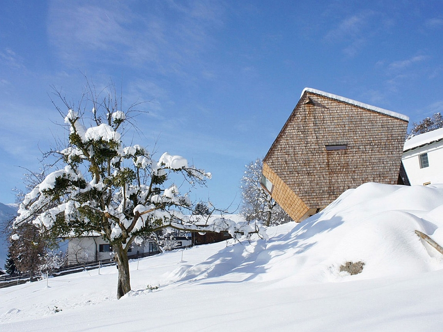 Snow covered slopes surround the Austrian holiday home