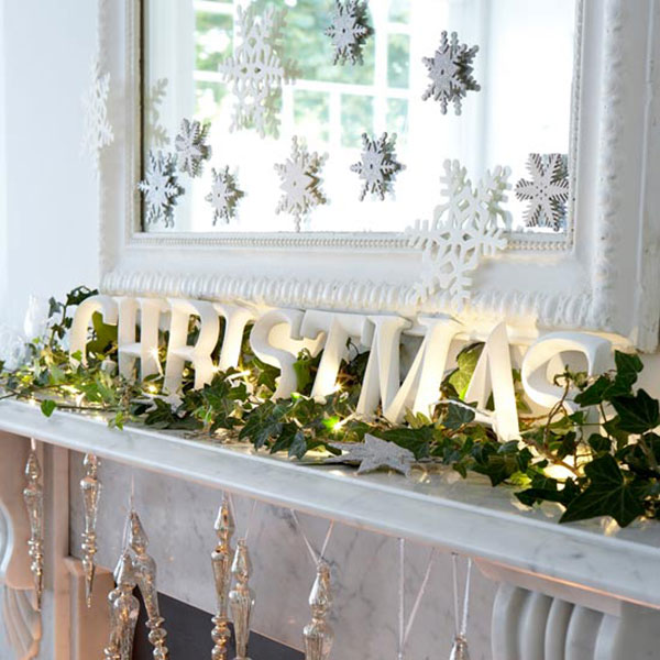 Snowflakes are a fun addition to the Christmas mantel decorations