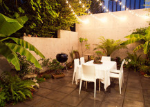 String lights over a verdant patio