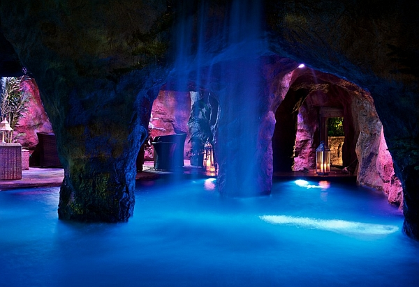 Stunning indoor pool with waterfalls and swim-through grotto that leads to a swim-up bar!