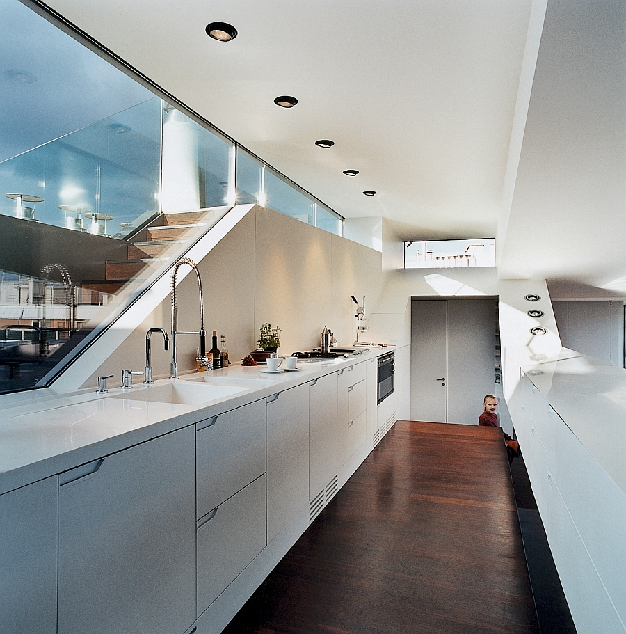 Stylish kitchen in white with recessed lighting