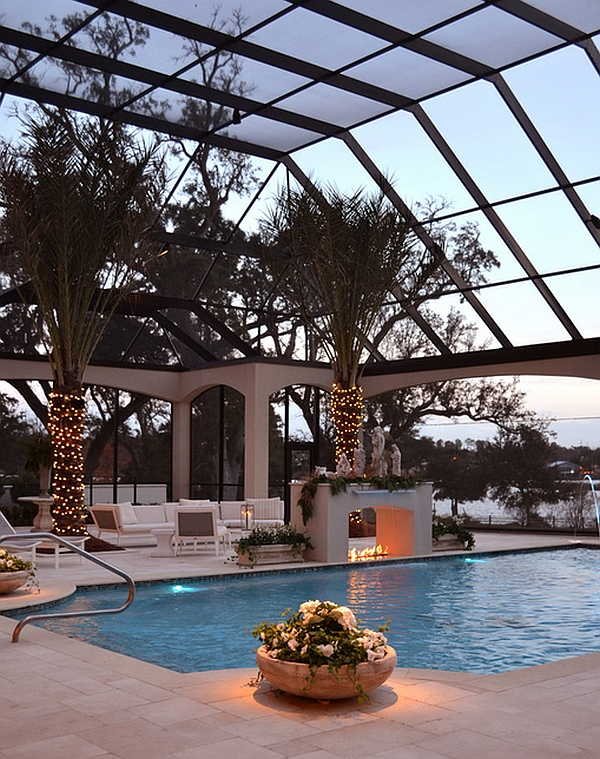 Stylish screened enclosure surrounds the pool