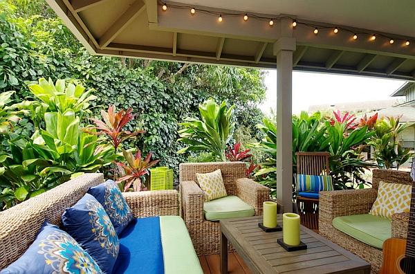 Subtle addition of string lights to the exquisite tropical porch