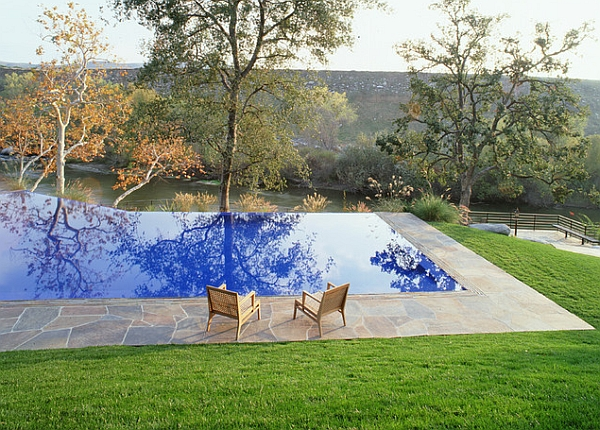 The blue waters of the pool reflecting the gorgeous landscape perfectlya