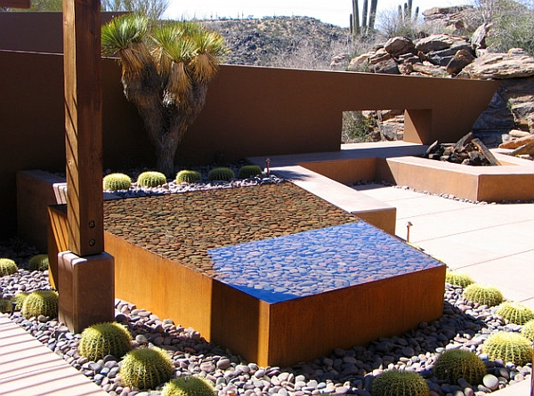 Trapezoidal water feature in the backyard with pebbles