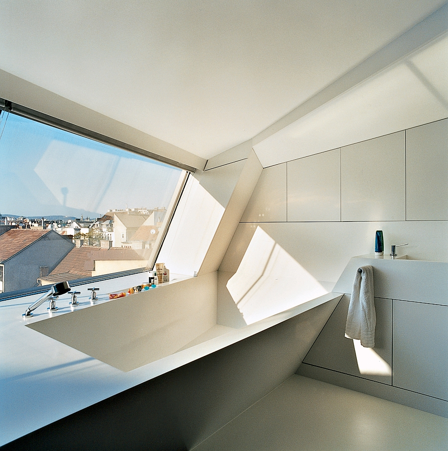 Ultra-modern bathroom with white Corian bathrub