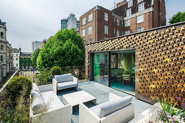 Elegant London Residence Dazzles With A Glittering Bronze Leaf Facade!