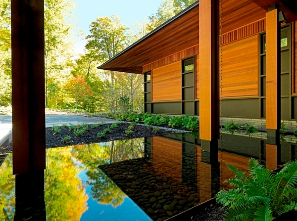 Use the reflecting pool to highlight the special architectural features of the house