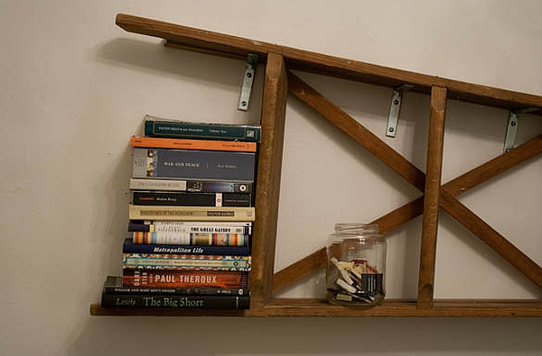Vintage ladder mounted horizontally on the wall