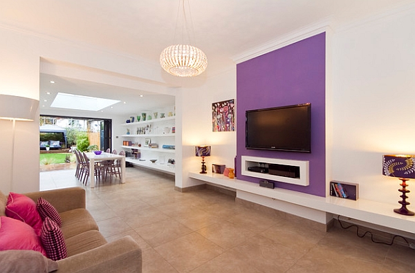 Vivacious accent wall in the living room in purple