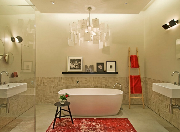Vivid red accents enliven the contemporary bathroom