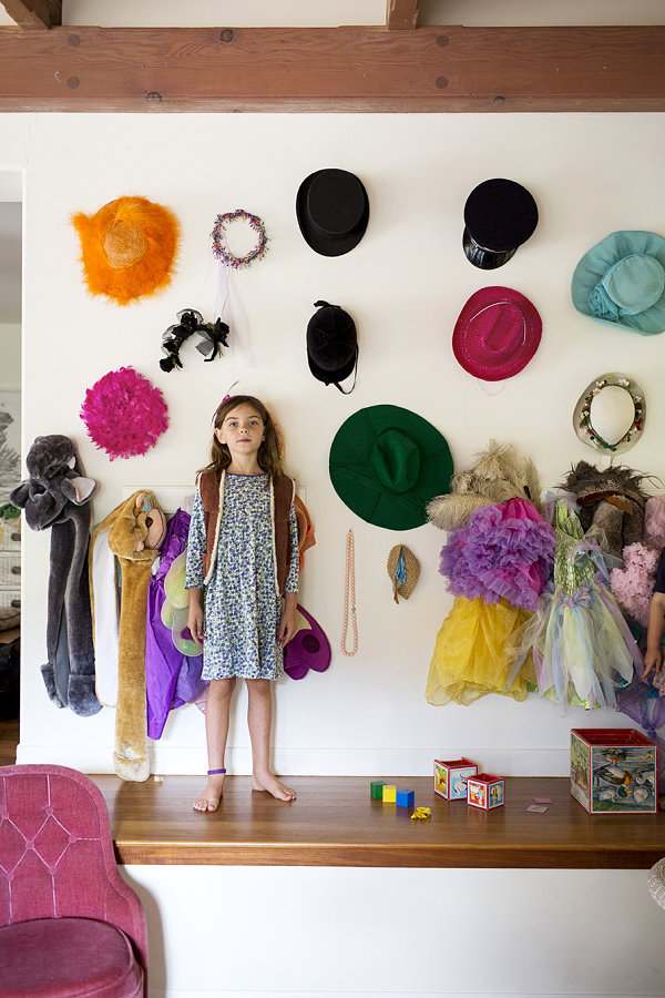 Wall of hats in a girl's room