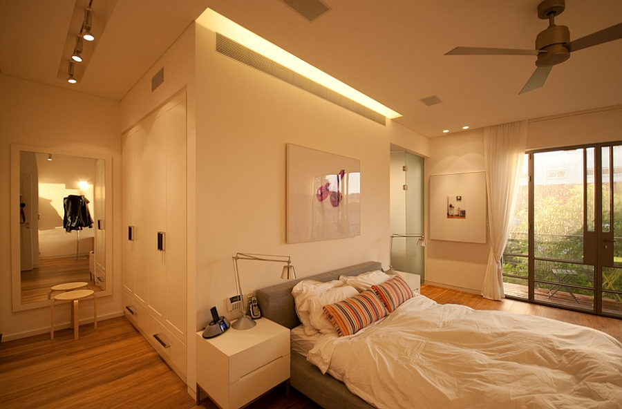Warmly lit bedroom in cream