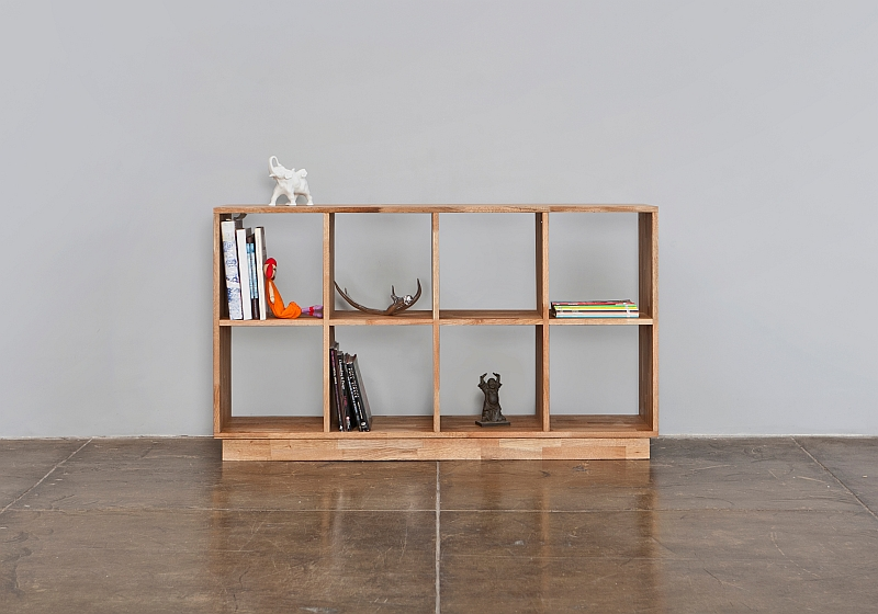 Wooden bookcase doubles as room divider and display