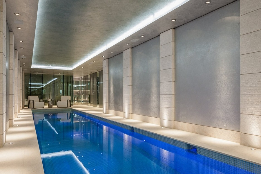 lavish indoor swimming pool with recessed lighting