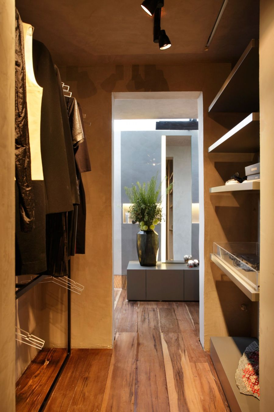 Art filled bachelor pad with cool design - Walk in closet ideas ...
