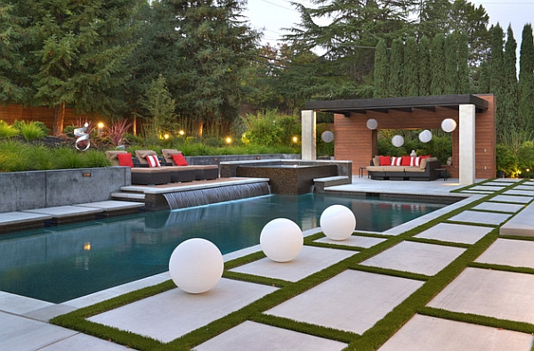 A perfect pool waterfall idea for those who love sleek minimalism