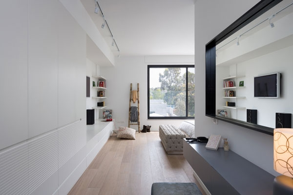 Ample storage options and stylish shelves in the bedroom